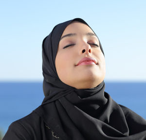 Arab woman breathing in fresh air