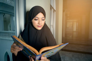 Woman reading the Qur'an